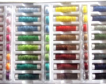 set of 32 + 32 canetttes polyester art sewing thread spools 2022370
