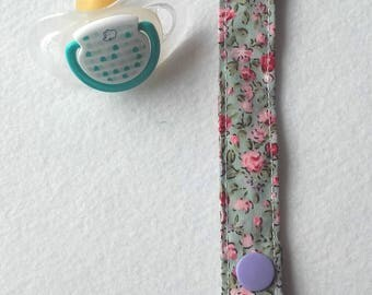 Green and pink liberty fabric pacifier with an adapter for all types of pacifier designs