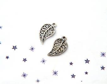 silver metal filigree intricately carved leaf