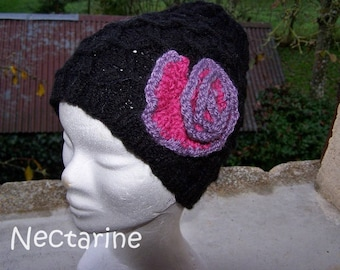 Hand knitted hat with fuschia flower black and purple