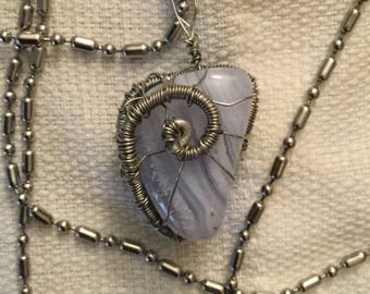 Polished blue laced agate crystal pendant