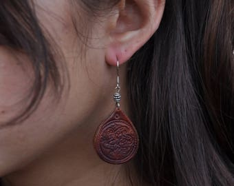 Brown tooled leather earring