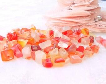 transparent red, orange stone nugget is 87 stones