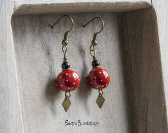 Red minimalist earrings with white dots