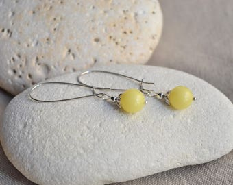 Silver earrings with yellow bead