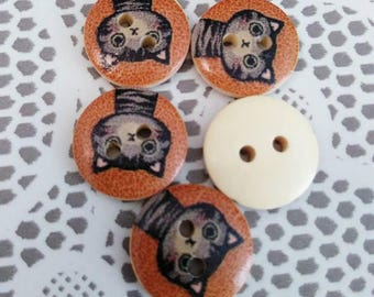 Set of 5 buttons wooden cats and a brown background