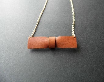 Bow tie leather pendant necklace