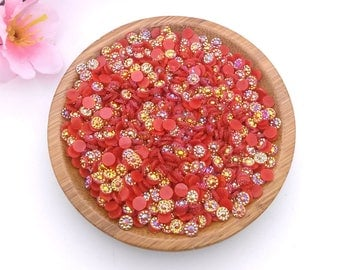 Set of 30 cabochons/rhinestones to stick in red acrylic