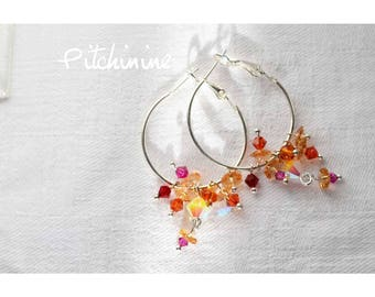 Creole, shades of Orange, pink and yellow crystals Swarovski and sterling silver findings.