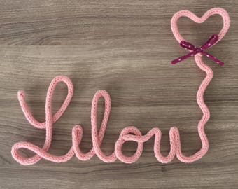 Name of knitting with heart and bow