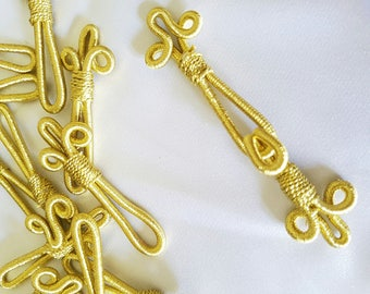 Pair of Golden clasps hooks - tie belts caftans or other item