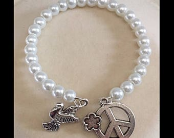"Pair of ""peace"" bracelet and glass beads."