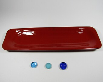 Red ceramic spoon rest fired.