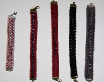 Cotton bracelets and beads crocheted with silver or copper metal fasteners
