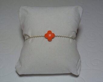 Orange clover bracelet on silver chain.
