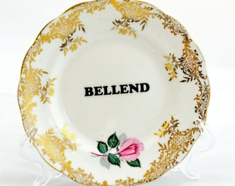 Vintage tea plate with modern musings (bellend)
