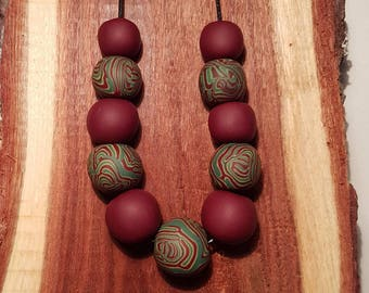 Red swirl polymer clay necklace