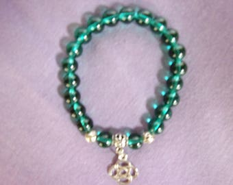 Emerald green stretch bracelet with celtic charm