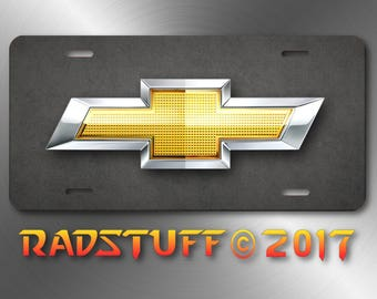Gold and Silver Chevy Logo Gray Grid Background