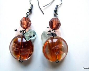 Orange glass earrings on copper and fluorite