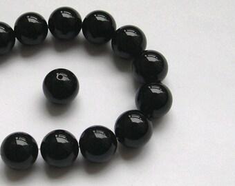 2 black beads and round 14 MM onyx gemstone