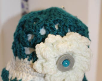 Teal baby hat with white flower
