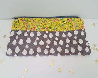 Case/pouch decorated with flowers in pastel colors