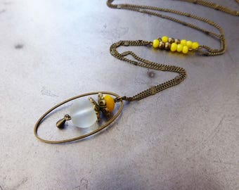 Necklace the mischievous, and yellow translucent faceted glass beads.