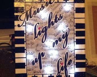 Light up music orientated Canvas art, great present for musicians - wording can be personalised to instrument of choice.