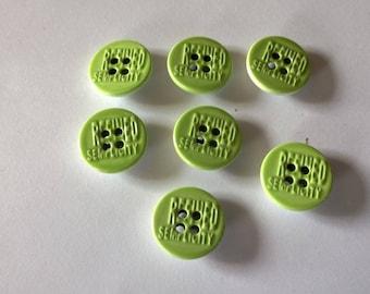 Set of seven green porcelain buttons