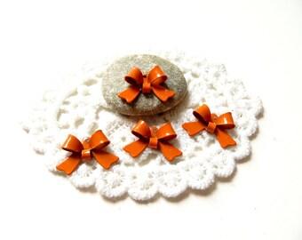 4 metal 16mm orange knots