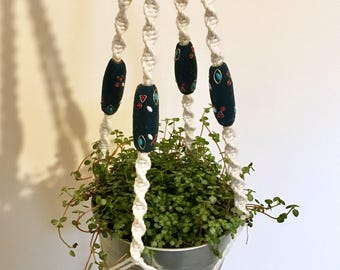 Cotton macrame plant hanger decorated with vintage beads. Boho decor. Home decor.