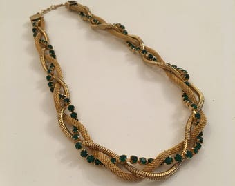 Vintage plaited gold tone necklace with green rhinestones