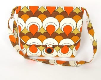 Recycled messenger bag with geometric pattern