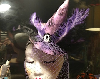 Halloween Fasinator / mini hat in purple with birdcage netting fixed onto headband.All hand dyed (including feathers!)