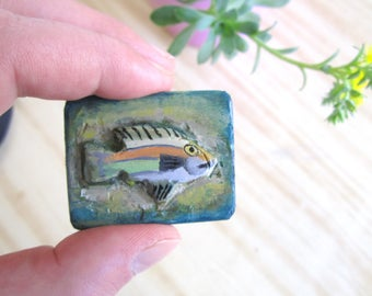Wooden magnet with relief carving of a fish