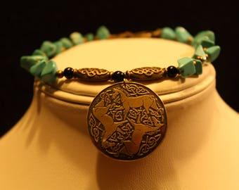 Turquoise bracelet with horse pendant