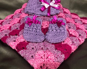 crocheted baby girl blanket and accessories