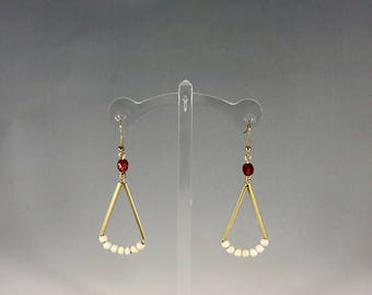 Gold bar earrings accented with various beads