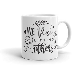 We rise by lifting others mug
