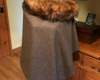 Stylish wool tweed poncho with detachable faux fur collar.