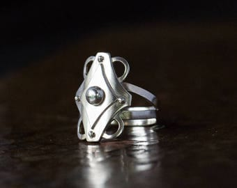 Silver ornamental ring, EU size 17.5 - 17.75