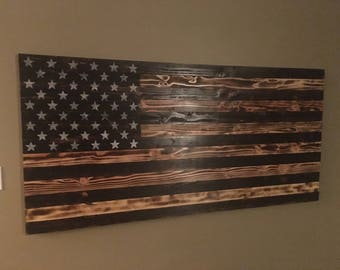 Charred, wooden, american flag