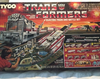 TYCO - Transformer Electric Train and Battle Set - HO Scale - 1985 New in Box