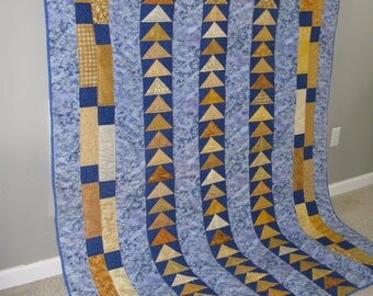 Hand quilted, original design, royal blue and gold sofa size Quilt