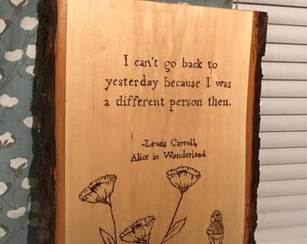 Alice in Wonderland wood sign with live edge.