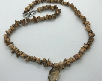 A28 Natural Zebra Jaspe with a quartz pendant.