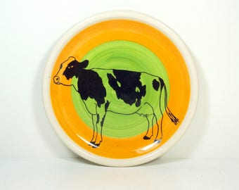 little plate with a Holstein Cow print on a color block orange and green READY TO SHIP