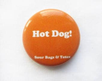"ON SALE Sour Bags & Totes Expression pins, ""Hot Dog! "" 1"" pin in Orange"