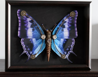 Steampunk butterfly sculpture with purple, blue and black wings